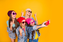 Close-up Photo Of Cool Carefree Charming Nice Ladies Showing Tongue-out Heavy Metal Symbols Small Photographer Taking Self Picture Of Fellow Friendship Group People Isolated Yellow Background
