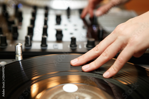 Female hip hop dj scratching vinyl records with music on party in night club Tablou Canvas