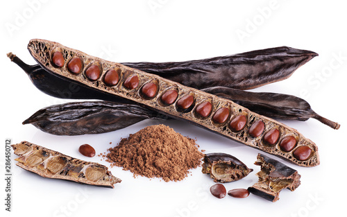 Fotografie, Obraz  Carob pods, bean and carob powder isolated on white background.