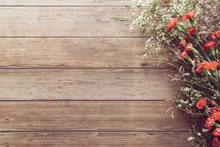 Flat Lay Of Garden Spring White And Red Tiny Flowers On Wooden Plank Table Background With Copy Space, Retro Color Style