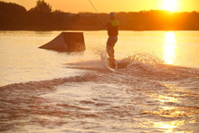 Shot Of Man Wakeboarding On A Lake