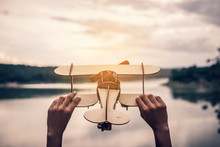 Hand Holding Wood Airplane In ...