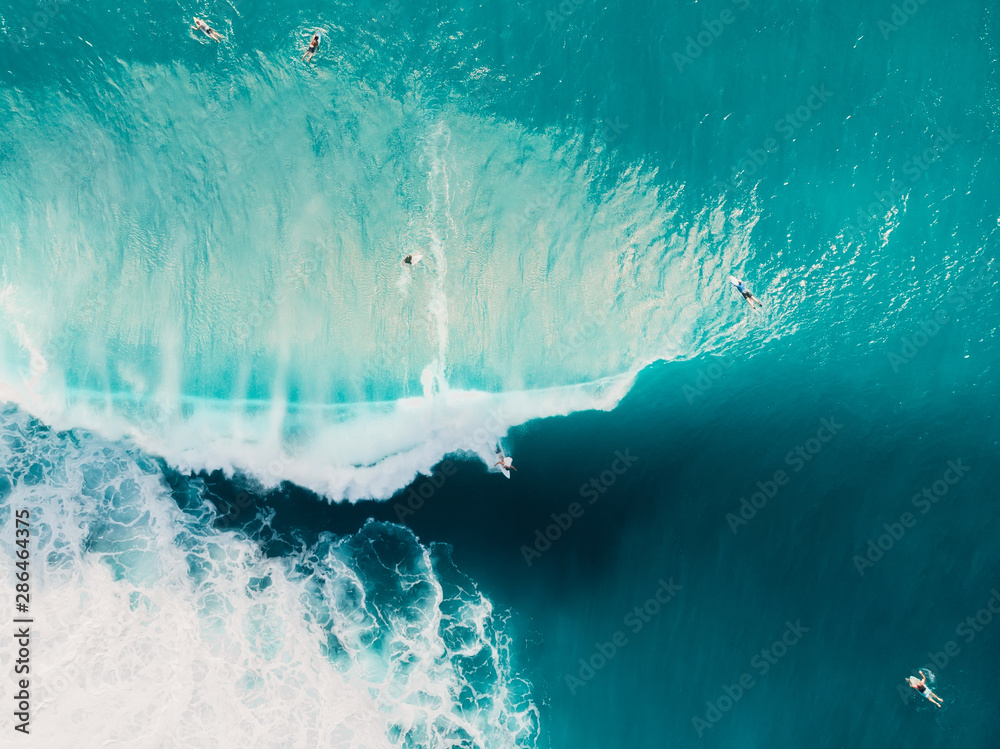Fototapety, obrazy: Aerial view of surfing at barrel waves. Blue wave in ocean and surfers