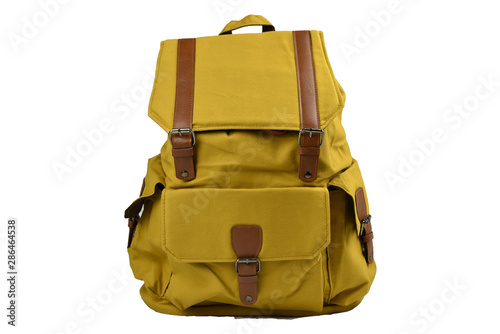 Fototapeta Canvas Backpack accessories isolated hipster background white. brown with yellow mustard canvas bag. Hand made backpack for travelers. front view obraz