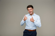 Image Of Cheerful Brunette Man Wearing Formal Clothes Smiling At Camera While Showing Thumbs Up