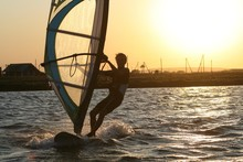 Windsurfer Rides At Sunset In ...