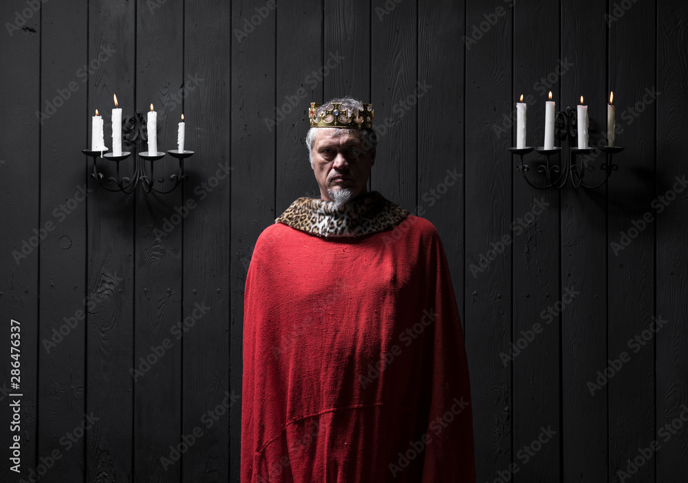 Fototapeta portrait of the old medieval king by candlelight