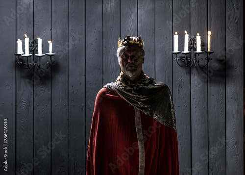 portrait of the old medieval king by candlelight Canvas
