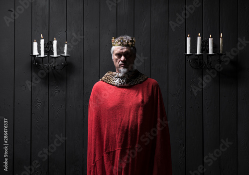 Canvas Print portrait of the old medieval king by candlelight