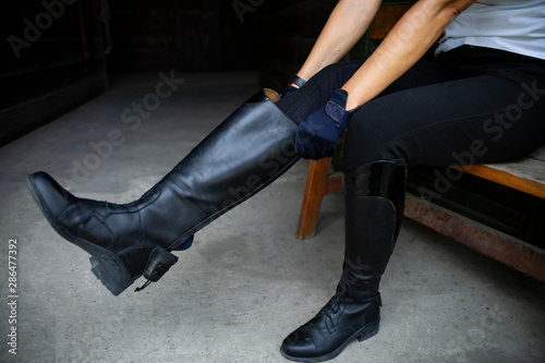 Equestrian sport. Leather equestrian boots. Riding clothes. Tablou Canvas