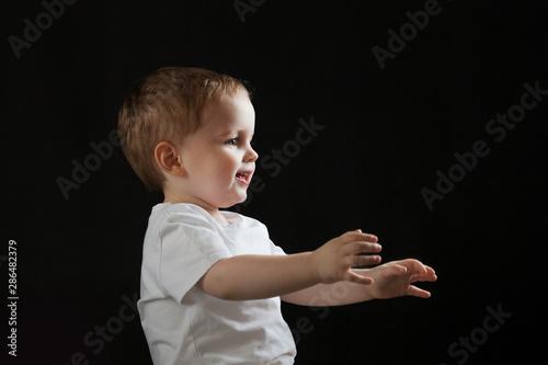 Valokuva Happy cheerful baby on black background