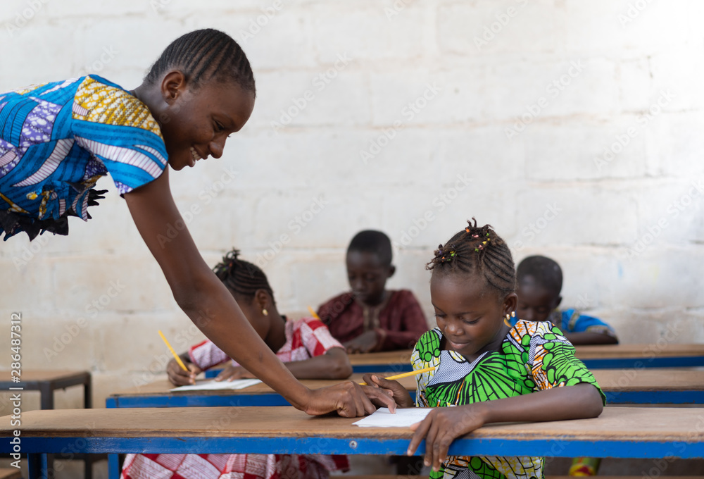 Fototapety, obrazy: Woman Teacher in School with her African Children Girls Pupils