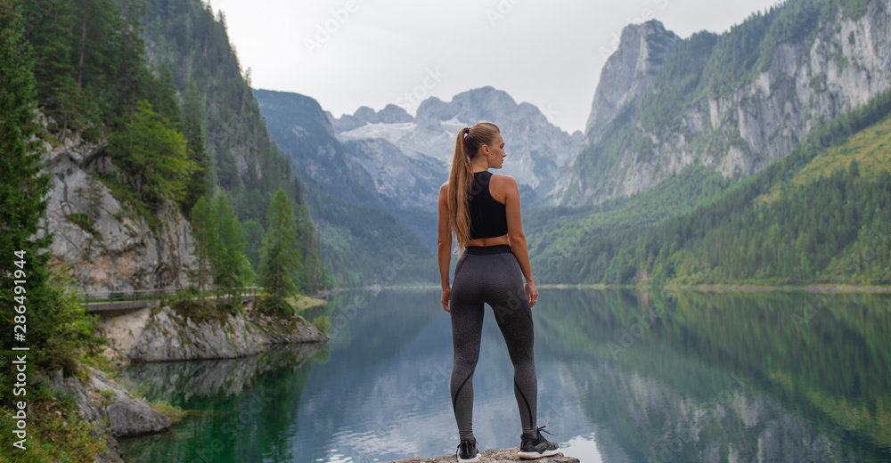 Fototapety, obrazy: Young sexy athletic girl in the mountains near the lake