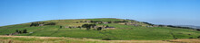 Long Panoramic View Of Green Fields And Village Stone Houses In Rolling West Yorkshire Dales Countryside In Colden With Blue Summer Sky