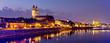 canvas print picture - Magdeburg an der Elbe mit Magdeburger Dom, Johanniskirche, mit Promenade am Ufer des Flusses in Abendstimmung mit Abendrot und beleuchteten Gebäuden im Panorama