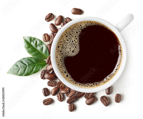 Photo sur Aluminium Cafe Cup of black coffee with beans and leaves