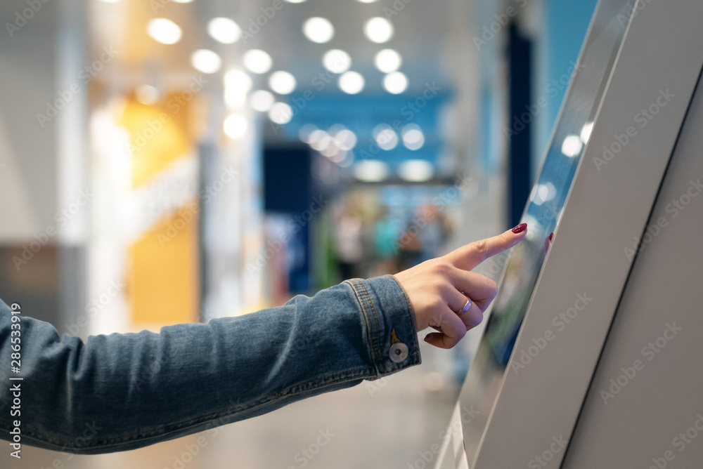Fototapeta Woman is touching a touch screen of interactive panel close up.