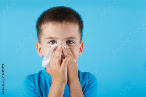 Photo  Child blow the nose.