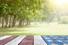 Independence Day 4th, Labor Day July USA Flag On Table Top In The Park For Background
