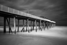 Old Wooden Fishing Pier Out To Ocean