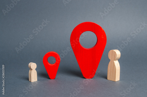 Small and big man near the red location pointers Canvas Print
