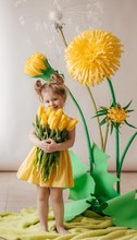 Portrait Of Beautiful Little Girl With Yellow Flowers