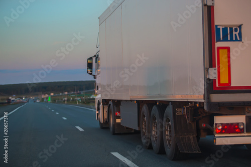 fototapeta na drzwi i meble truck goes on highway on sunset