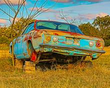Vintage Chevrolet Corvair In Field