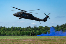 Landing Of Swedish Military Helicopter Blackhawk UH-60 On Airshow At Ronneby Flygdag Military Armed Men With Smoke Bomb