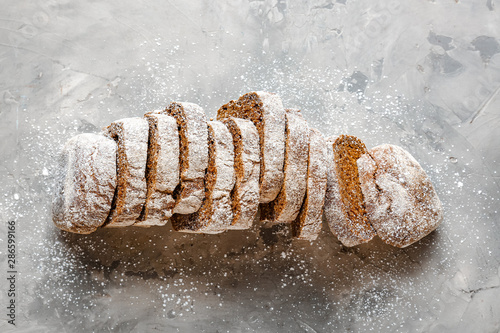 Tasty cut bread on grunge background