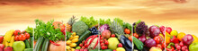 Useful Fruits And Vegetables Divided Vertical Lines Against Background Sunset