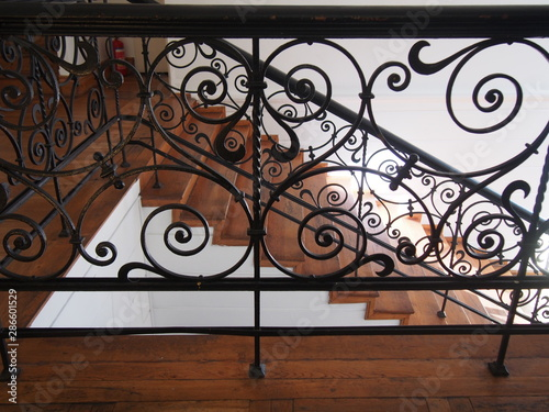 Fotografía Staircase baluster of an old building in Szczcin Poland, metal works with whirli
