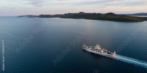 Fotografía Aerial view of car ferry with Ugljan island in background at dusk, Croatia