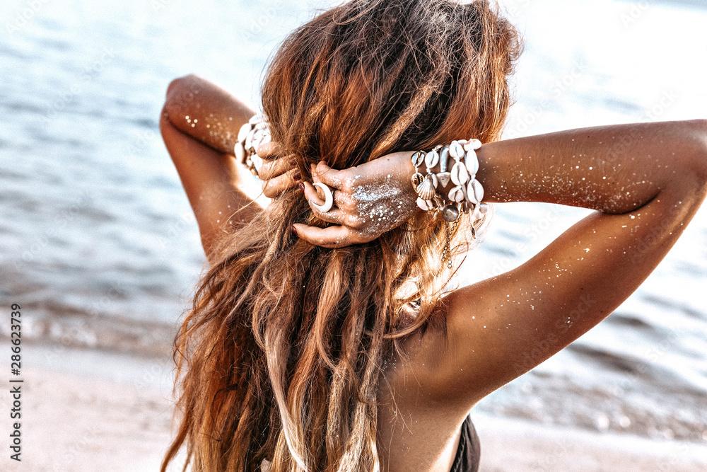 Fototapety, obrazy: beautiful young stylish woman on the beach at sunset