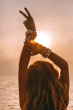 Silhouette Of Young Woman Showing Victory With Her Fingers