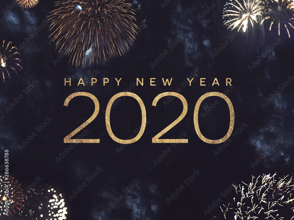 Fototapeta Happy New Year 2020 Text with Gold Fireworks in Night Sky
