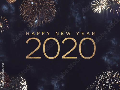 Cuadros en Lienzo  Happy New Year 2020 Text with Gold Fireworks in Night Sky