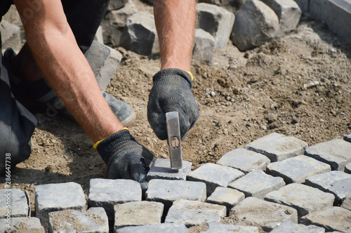 worker stacks paving stones Wallpaper Mural