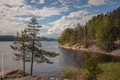 Valokuvatapetti Landscape with a lake, forest and road