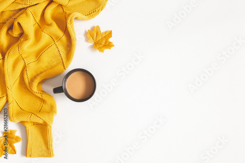Autumn composition. Cup of coffee, yellow sweater on white background. Autumn, fall concept. Flat lay, top view, copy space - 286652103