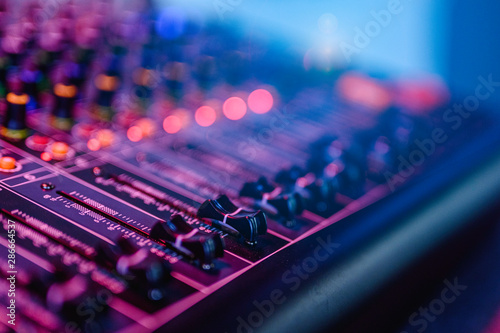 Fotomural Professional audio mixing console in concert.