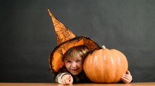 Child With Pumpkin. Happy Hall...