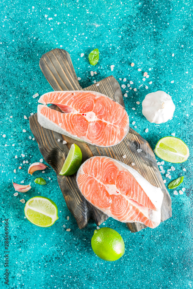 Fototapety, obrazy: Raw salmon fish steaks with spices