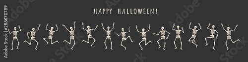 Fotografie, Tablou  Banner of 13 dancing and jumping skeletons isolated on a black background