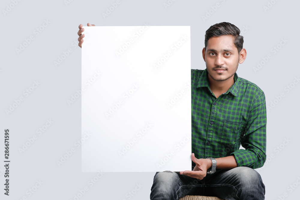 Fototapety, obrazy: young indian guy holding blank poster