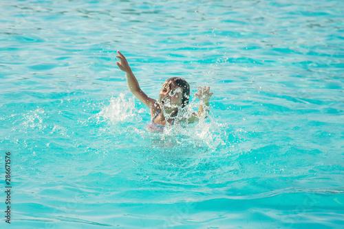 Fotografija kid is drowning in the sea. Selective focus.
