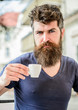 Enjoy hot drink. Hipster drinking fresh brewed coffee. Bearded guy consume caffeine. Espresso arabica only. Coffee break concept. Guy relaxing espresso. Man with beard and mustache and espresso cup