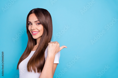 Close up photo of pretty youth showing advertisement on copy space smiling weari Canvas Print