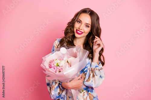 Obraz na plátně  Photo of overjoyed lady holding hands big bunch wear cute dress isolated pink ba