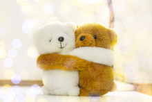 White And Brown Teddy Bears Hugging With Light And Bogey.